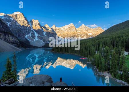 Beautiful view of Moraine Lake at Sunrise in Banff National Park, Canada. - Stock Photo