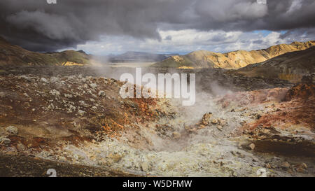 Steam rising from the volcanic mountains in Iceland - Stock Photo