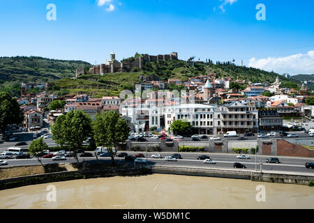 Narikala fortress overlooking the old town of Tblisi, Georgia. The domed steeple of St Nicholas church is visible above the fortress wall. - Stock Photo