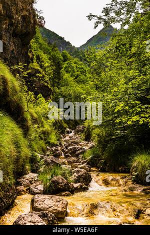 Waterfall down a side channel in to Lago del Mis, near Belluno, Veneto, Italy - Stock Photo