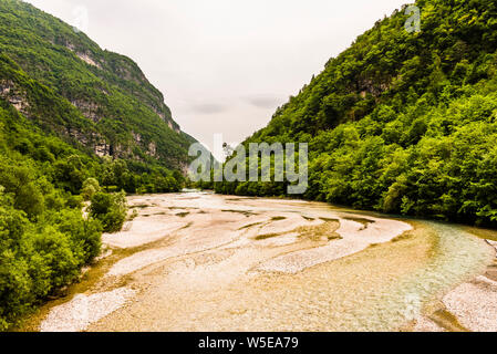River flowing in to Lago del Mis, near Belluno, Veneto, Italy - Stock Photo