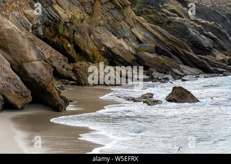 Wood's Cove in Laguna Beach, CA, is a little gem of a cove with impressive and colorful cliffs, sandy beaches and rock outcroppings. - Stock Photo