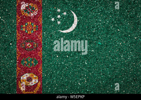National flag of Turkmenistan on a stone background.The concept of national pride and symbol of the country. - Stock Photo