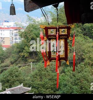 Nanning, China - Nov 2, 2015. A wooden lantern at ancient palace in Nanning, China. Nanning is a city in southern China near the Vietnam border. - Stock Photo