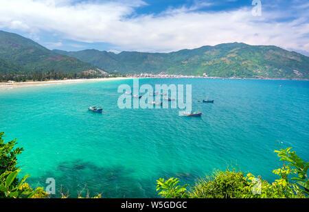 Fishing Boats in the beautiful Vung Ro bay in Phu Yen, Vietnam - Stock Photo