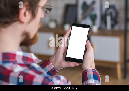 Mockup image - man holding black smartphone with white blank screen - Stock Photo