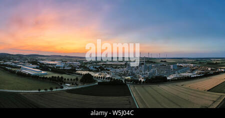 Southeastern aerial view of the industrial area of Brilon. Panorama at sunset. Very detailed. - Stock Photo