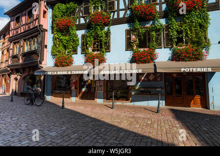 exuberant flower decoration of the Alsace, France, village Kaysersberg on the Wine Route - Stock Photo