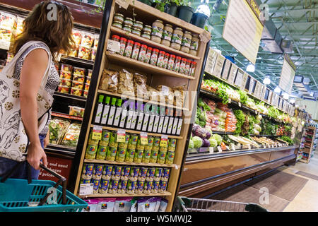 Miami Beach Florida Whole Foods Market supermarket company business groceries natural organic shopping produce vegetables shelf - Stock Photo