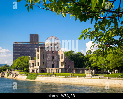 The Hiroshima Peace Memorial (Genbaku Dome, Atomic Bomb Dome or A-Bomb Dome) and the Ota River in Hiroshima, Japan. - Stock Photo