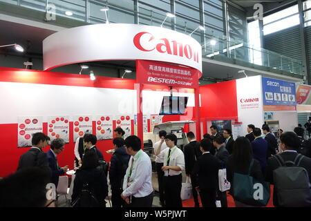 --FILE--People visit the stand of Canon during an exhibition in Shanghai, China, 20 March 2019.   Canon, the Japanese multinational imaging and optica - Stock Photo