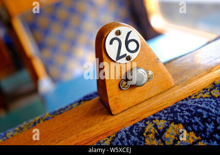 number 26 numeral on old railway carriage seat, sheringham, north norfolk, england - Stock Photo