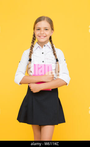 School lesson. Study literature. Inspirational quotes motivate kids for academic year ahead. School girl formal uniform hold book. Towards knowledge. Learn following rules. Welcome back to school. - Stock Photo