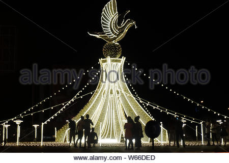 Lights for christmas decoration in the night in Lome, Togo - Stock Photo