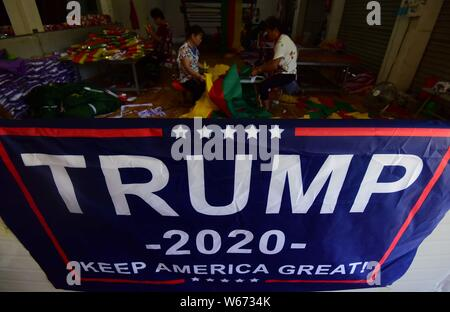 --FILE--A flag for the U.S. President Donald Trump's 2020 presidential re-election campaign to be exported to the United States of America is displaye - Stock Photo
