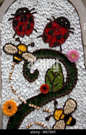 Well dressing in Swanwick - the art of decorating springs and wells with pictures made from natural materials, mainly flowers is an ancient custom fou - Stock Photo