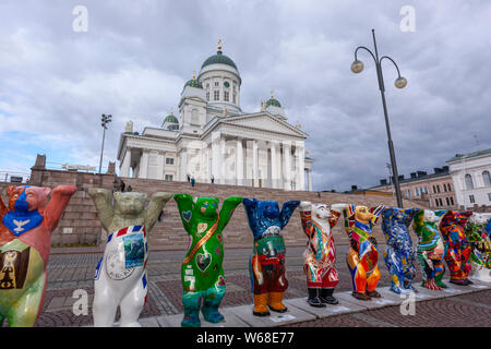 The United Buddy Bears exhibition, fiberglass bear sculptures Klaus and Eva Herlitz, with sculptor Roman Strobl, Helsinki Senate Square and Cathedral - Stock Photo