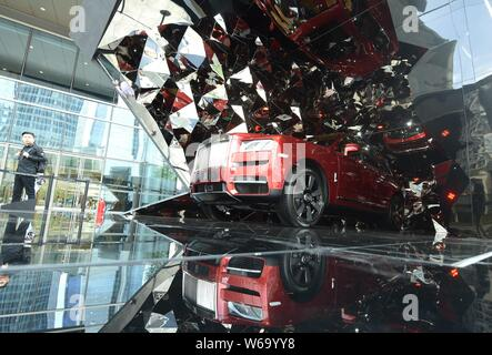 A Cullinan SUV of Rolls-Royce is on display at a shopping mall in Hangzhou city, east China's Zhejiang province, 19 June 2018.   Love or hate the fact - Stock Photo