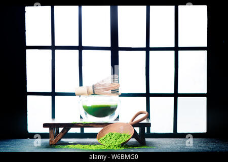Matcha green tea header with Shoji sliding doors background. Traditional Japanese room, preparation for tea ceremony - Stock Photo