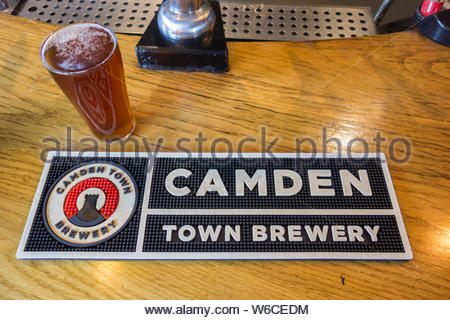 Camden Town Brewery beer mat on a pub counter, London, UK - Stock Photo