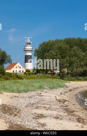 Lighthouse Bülk and beach of Strande near Kiel on the Baltic Sea coast - Stock Photo