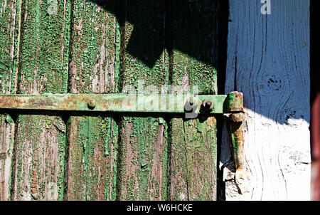 part of an old door with hinges - Stock Photo