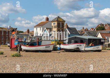Aldeburgh fishing boats on the pebble beach in front of the Aldeburgh beach lookout tower, Suffolk England - Stock Photo