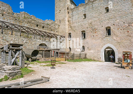 Rakvere, Estonia, June 28: The commander of a cuirassier squad enters the courtyard of an old castle in Rakvere, June 28, 2019. - Stock Photo