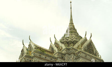 BANGKOK, THAILAND- JUNE, 21, 2017: the roof of a building in the wat arun temple complex in bangkok, thailand - Stock Photo
