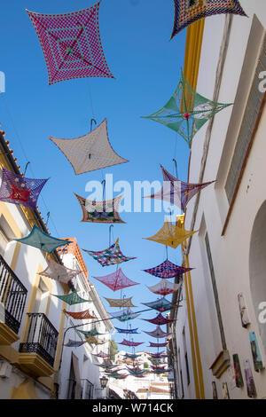 Crochetted umbrella art in Gaucin, Andalucia, Spain - Stock Photo