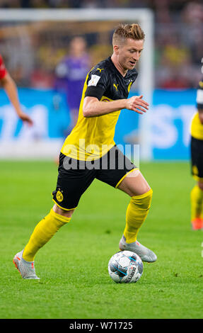 03 August 2019, North Rhine-Westphalia, Dortmund: Soccer: DFL Supercup, Borussia Dortmund - Bayern Munich in Signal Iduna Park. Dortmund's Marco Reus on the ball. Photo: Guido Kirchner/dpa - IMPORTANT NOTE: In accordance with the requirements of the DFL Deutsche Fußball Liga or the DFB Deutscher Fußball-Bund, it is prohibited to use or have used photographs taken in the stadium and/or the match in the form of sequence images and/or video-like photo sequences. - Stock Photo