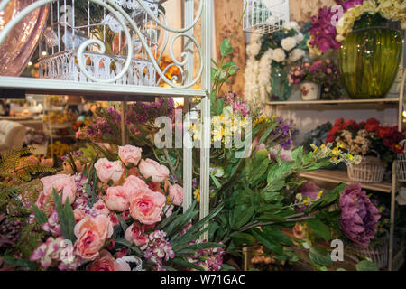 collection of beautiful floral bouquets and plants in flower shop - Stock Photo