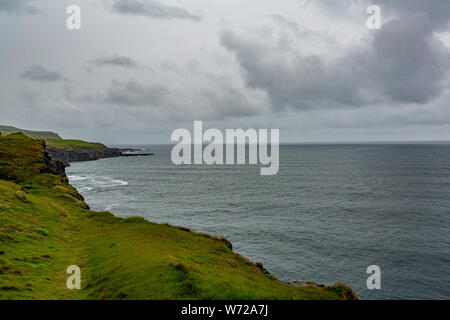 Beautiful landscape of the sea in the Irish countryside along the coastal walk route from Doolin to the Cliffs of Moher, Wild Atlantic Way - Stock Photo