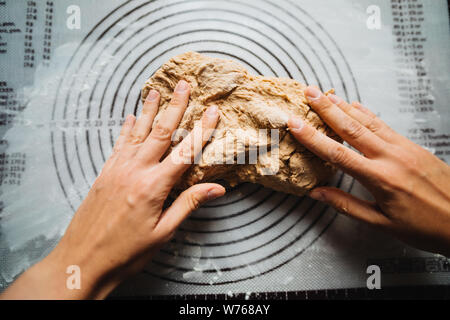 Making dough by female hands. Homemade. Preparation of bread - Stock Photo
