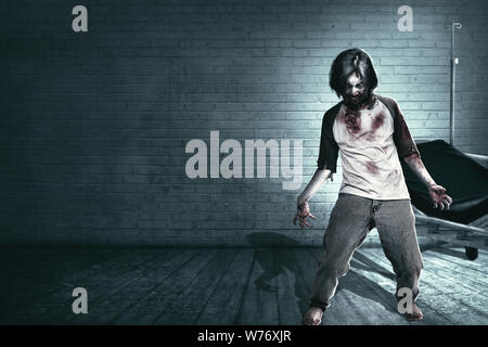 Scary zombies with blood and wound on his body haunted the abandoned hospital. Halloween concept - Stock Photo