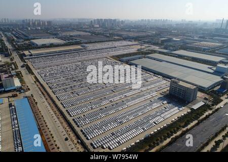 Aerial view of massive new vehicles lined up for sale at an automobile plant in Xiangyang city, central China's Hubei province, 26 November 2017.   Ma - Stock Photo