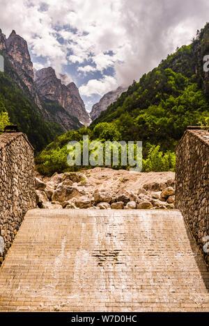 River channel flowing in to the Torrente Cimoliana near Cimolais, Friuli-Venezia Giulia, Italy - Stock Photo