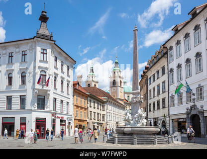 People visitors and tourists in Ljubljana Town Square in front of the new Robba fountain Stritarjeva ulica Old Town Ljubljana Slovenia Eu Europe - Stock Photo