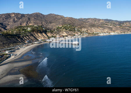 Aerial of Surfrider Beach, Malibu Pier and the Santa Monica Mountains north of Los Angeles in Southern California. - Stock Photo