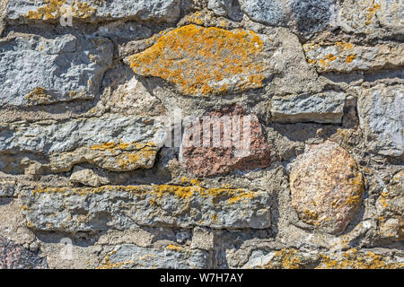 Dark fragment of an old stone wall for use as an abstract background and texture. - Stock Photo