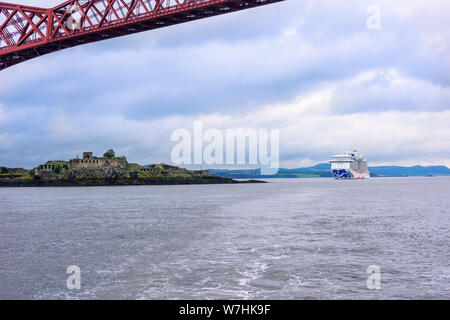 South Queensferry, Scotland - August 13, 2018:  Princess cruise ship, the Royal Princess, anchored in the Firth of Forth near an uninhabited island - Stock Photo