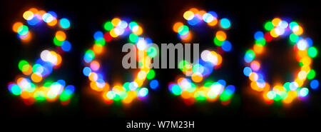 Happy 2020. Happy new year abstract concept. Numbers made with decorative garland bokeh lights - Stock Photo