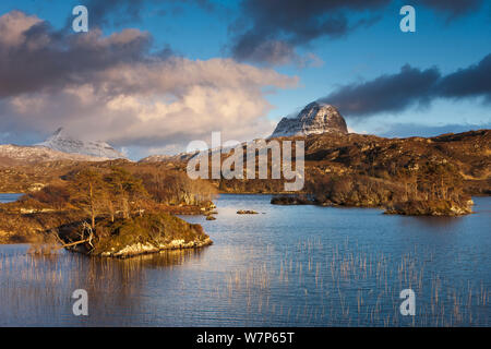 Loch Druim Suardalain with Mount Canisp and Mount Suilven dusted in snow, Sutherland, Scotland April 2012 - Stock Photo
