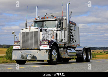 Vaulammi, Finland. August 3, 2019. Classic Kenworth W900B semi tractor trucking on highway on Maisemaruise 2019 car cruise in Tawastia Proper, Finland - Stock Photo