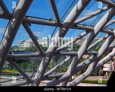 Bridge of peace crossing river Kura- Mtkwari, left bank with presidential Palace and Sameba Cathedral, Tbilisi, Georgia, Europe - Stock Photo