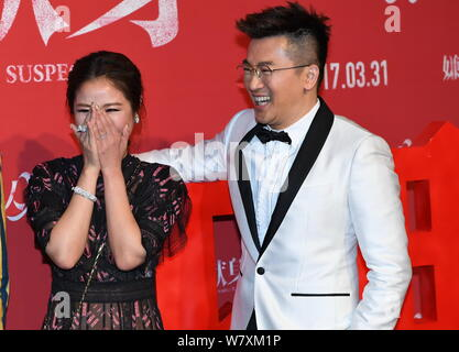 Taiwanese actress Ruby Lin, left, interacts with actor and director Alec Su at the premiere of their new movie ''The Devotion of Suspect X'' in Beijin - Stock Photo