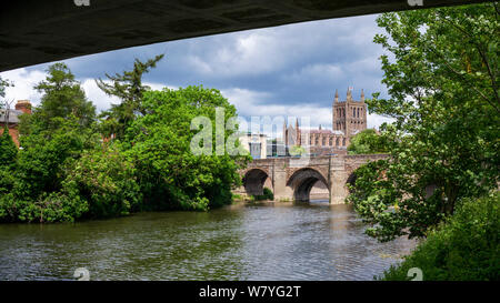 The 15th century bridge over the River Wye, and Hereford Cathedral, seen from beneath the more modern Greyfriars Bridge, Hereford, Herefordshire, UK - Stock Photo