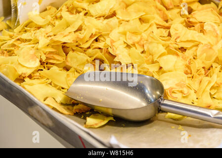 Heap of fried Durian chips is sold in local Thai market. Traditional crispy Thai dessert dry Durian. - Stock Photo