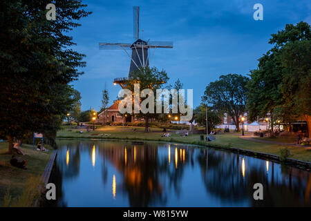 Iconic dutch Windmill in the University town of Leiden in the Netherlands at night time - Stock Photo