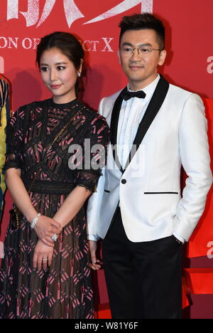 Taiwanese actress Ruby Lin, left, and actor and director Alec Su pose at the premiere of their new movie ''The Devotion of Suspect X'' in Beijing Chin - Stock Photo
